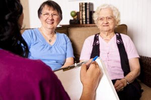 iStock_Senior-woman-daughter-caregiver in foreground-20801905_small